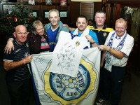 Tony O'Neill, Leeds United, centre of picture making a presentation of a Leeds Football Signed Jersey by the team to Kerry Supporter Joe Flynn at a Leeds Kerry supporters club at the Castle bar on Thursday night. LtoR. Joe Hanley, Anne Pullen, Joe Flynn, Tony O'Neill, Joe Quirke, and Michael (Fox) O'Connor. Photo: John Cleary.