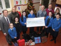Presentation Primary Schoolchildren hand over a cheque of €500 to St Vincent de Paul Tralee, from left, front: Julia Lelito, Katie Dowling, Elle Daughton, Clodagh McCluskey, Chrsty Lynch, Eva McGrath and Kasey McCormick. Back, from left: Principal Patrick Sayers, Claire Tobin, John Joe Roche and Helena Hennessy. Photo by Gavin O'Connor.