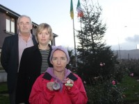 At the 'Remembrance Tree' outside the motor tax building on Prince's Street were from left, Frank Harnett (Kerry County Council) Jean Foley (Kerry County Council) and Sharon Roche.