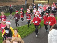 Participants of the Santa Run head off from the Wetlands. Photo by Gavin O'Connor.