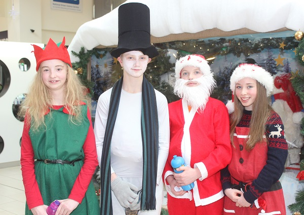 Scoil Eoin sixth class pupils who were Christmas caroling in Manor West on Wednesday afternoon were, from left: Rachel O'Carroll, Joe Reidy, Joey Nagle and Caoimhe Leahy. Photo by Gavin O'Connor.