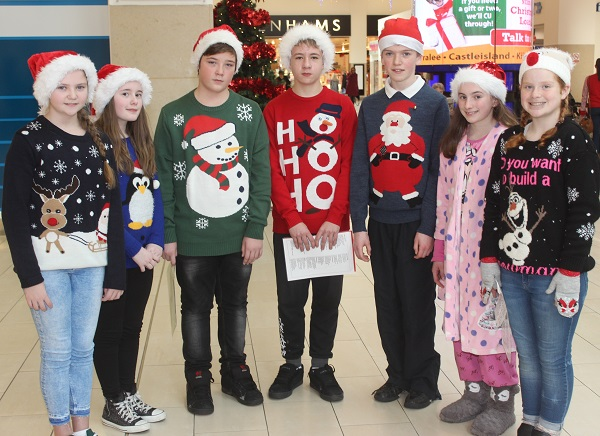 Scoil Eoin sixth class pupils who were Christmas caroling in Manor West on Wednesday afternoon were, from left: Ciara Madden, Siona Lynch, Chris Chekall, Nicolo Dilski, Adele O'Connor and Leanne Russell. Photo by Gavin O'Connor.