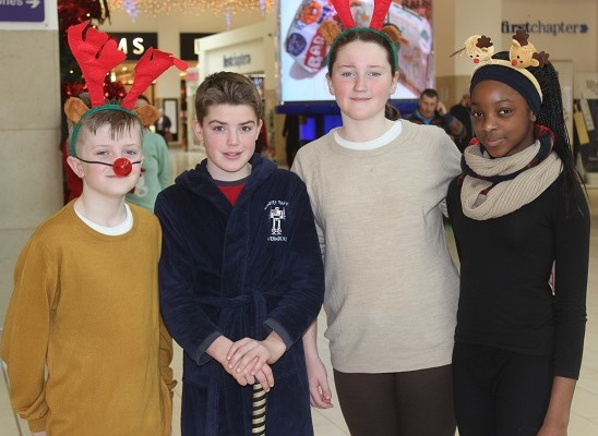 Scoil Eoin sixth class pupils who were Christmas caroling in Manor West on Wednesday afternoon were, from left: Conor O'Brien, Brian McElligott, Kirbyanne Ryan and Katrina Duyile. Photo by Gavin O'Connor.