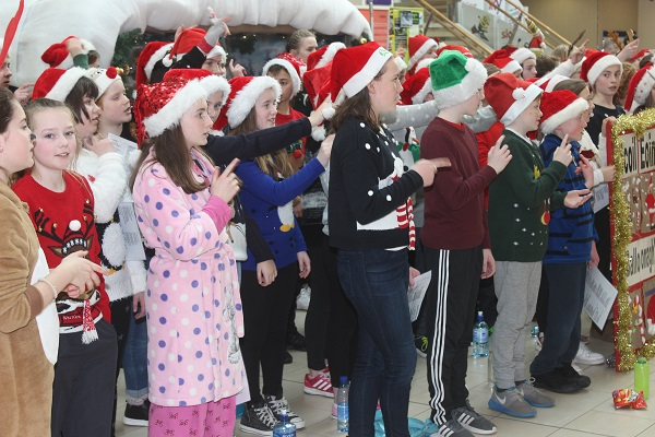 Pupils from Scoil Eoin singing Christmas carols in Manor West. Photo by Gavin O'Connor.