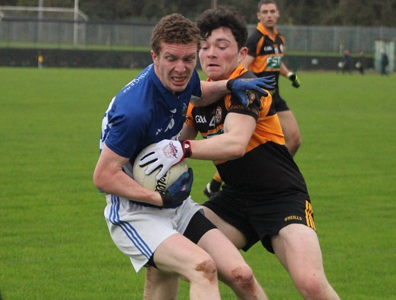 Austin Stacks, Jack O'Shea, puts in a tackle on John Tyther. Photo by Gavin O'Connor.
