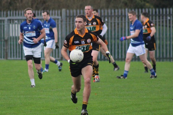 Austin Stacks, Fiachna Mangan, comes away with the ball. Photo by Gavin O'Connor.