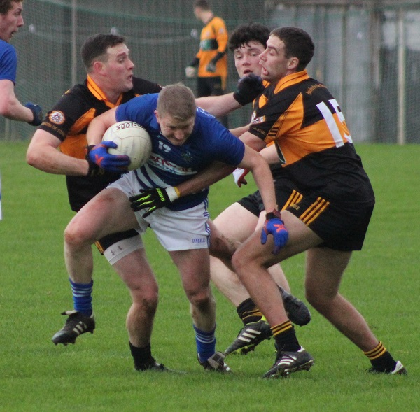 Mike Frank Russell, is tackled by John Dennis, Jack O'Shea and Fiachna Mangan. Photo by Gavin O'Connor.