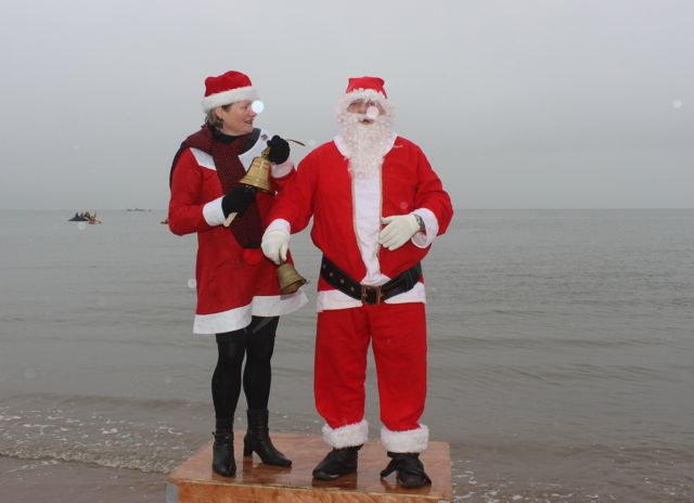 Santa and Mrs Claus about to ring the bell to start the Christmas Day swim in Fenit. Photo by Dermot Crean