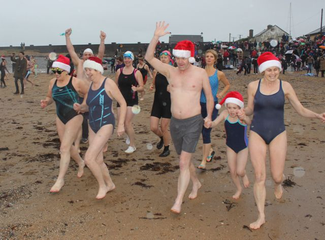 Swimmers dashing into the water for the Christmas Day swim in Fenit. Photo by Dermot Crean