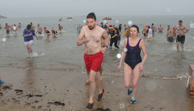 Bet that was cold...dippers leaving the water for the Christmas Day swim in Fenit. Photo by Dermot Crean