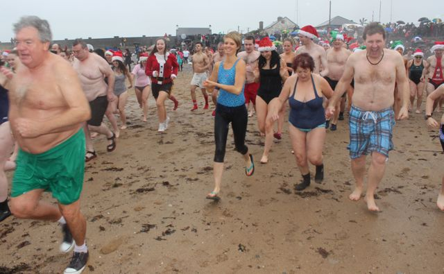 Gluttons for punishment making a second dash into the water for the Christmas Day swim in Fenit. Photo by Dermot Crean