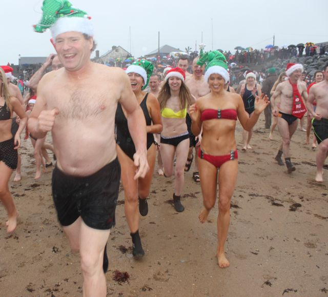 Swimmers dash into the water for the Christmas Day swim in Fenit. Photo by Dermot Crean