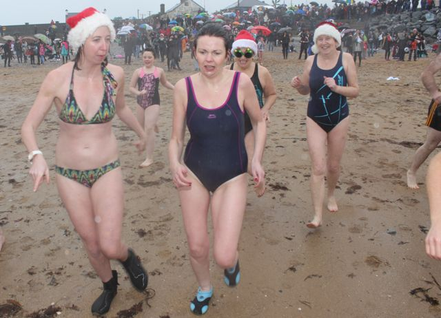 These swimmers don't look too happy making a second dash into the water for the Christmas Day swim in Fenit. Photo by Dermot Crean
