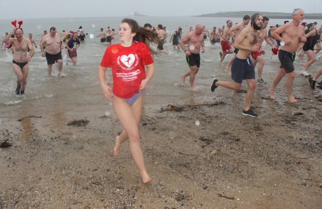 Retreating from the water for the Christmas Day swim in Fenit. Photo by Dermot Crean