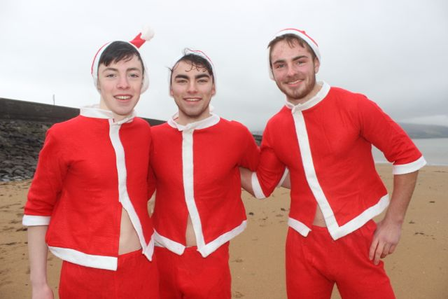 Philip and David Corkery and Michael Moran at the Christmas Day swim in Fenit. Photo by Dermot Crean