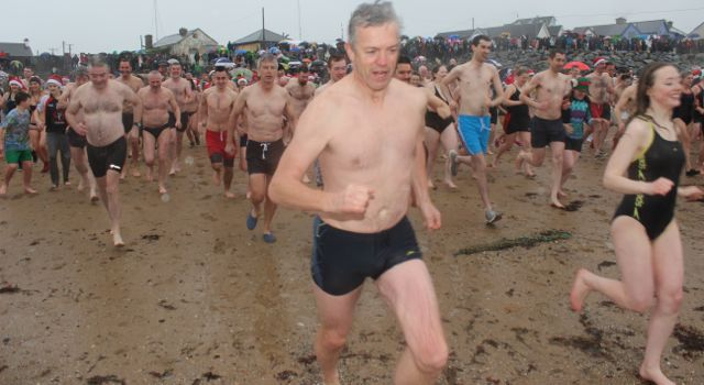Dashing towards the water for a third time for the Christmas Day swim in Fenit. Photo by Dermot Crean