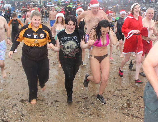 One more time...dashing towards the water for the Christmas Day swim in Fenit. Photo by Dermot Crean