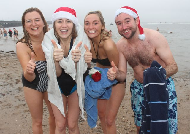 It's all over and these bathers look happy at the Christmas Day swim in Fenit. Photo by Dermot Crean