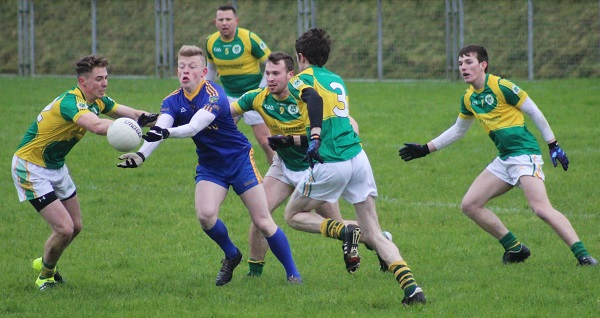 Spa's, Evan Cronin, is hounded by the Mitchels defence. Photo by Gavin O'Connnor.