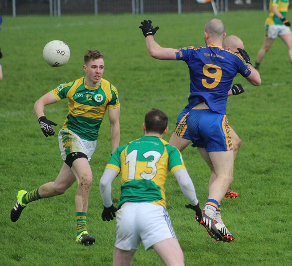 John Mitchels, George Bastible, lays off a pass for Niall Sheehy, Photo by Gavin O'Connnor.