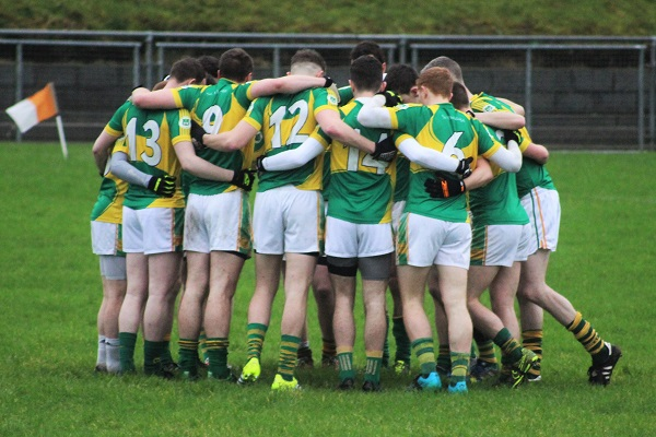 the John Mitchels team huddle before throw in. Photo by Gavin O'Connor.