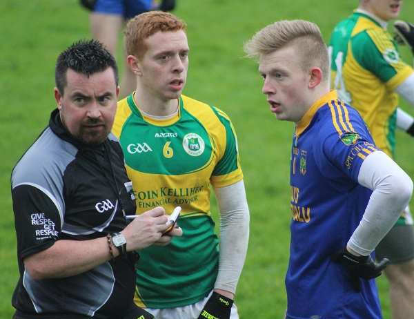 John Mitchels, Laurence Bastible and Spa's Evan Cronin, are spoken to by match referee Seamus Mulivihill. Photo by Gavin O'Connor.