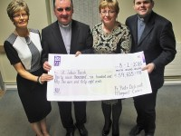 With the cheque from the 2016 St John's Bazaar are from left, Catherine Dwyer,  Francis Nolan, Margeret Crean and Fr Piotr Delimat. Photo by Gavin O'Connor.