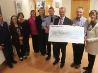 At the cheque handover of €7,930 to Kerry Hospice from Chief Superintendent Pat Sullivan's retirement coffee morning were, from left: John Sheehy, Farah Siddiqi, Mary Shanahan, Linda O'Connor, Garda Fiona O'Dowd, Sargent Michael Fleming, Pat Sullivan, Dan Galvin and Maura Sullivan. Photo by Gavin O'Connor.