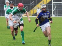 Kerry's Jack Goulding is pursued by Limerick's Seamus Hickey. Photo by Gavin O'Connor.