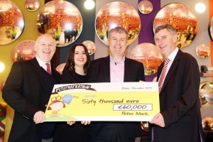 Pictured are Ruth O'Connor, Peter Mark and Peter O'Rourke, CEO Peter Mark presenting a cheque of €60,000 from its annual Petermarkathon to Drew Flood, AWARE and Dominic Layden CEO AWARE. The monies raised will go specifically towards AWARE's work supporting and educating teenagers about looking after their mental health.