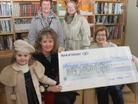 Presenting the cheque were Michelle McElligott to Maureen O'Brien of Recovery Haven. Also included are  little Roisin Kerins,  and at back Helen McElligott and Rose O'Callaghan. Photo by Dermot Crean
