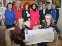 In front; Anne Kerins presents a cheque for €500 to Recovve
