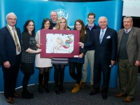 Elisha Buckley (centre) with her National Winning Art Piece with Irish League of Credit Unions President Brian McCrory, Marty Whelan, Suzanne Ennis Tralee Credit Union, Mum Carol, Father Leonard, sister Meabh, brother Leonard and John O'Regan Chapter 23.