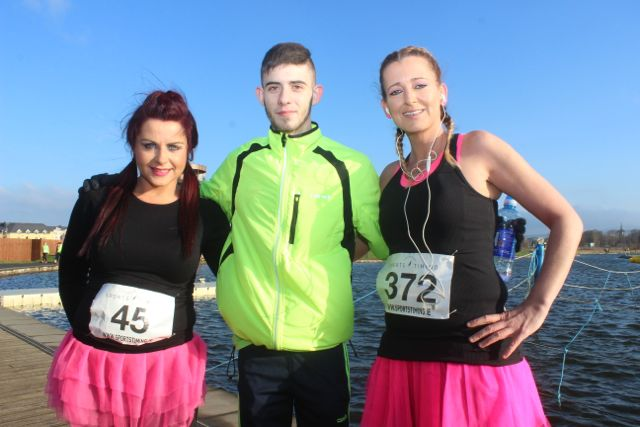 Sabrina McCaffrey, Mickey O'Shea and Cindy O'Shea at the start of the Valentine's 10 Mile Road Race from Tralee Wetlands on Sunday morning. Photo by Dermot Crean