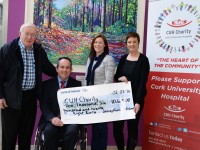 Kerry man, John Garvey (left) and daughter Claire O'Shea (third from left) present a cheque for €10,628 to Bernie O'Halloran, CUH Charity and Damian McGovern, Business Manager, CUH, to enhance patient care for Cancer, Neurology, and Cystic Fibrosis Services at Cork University Hospital.