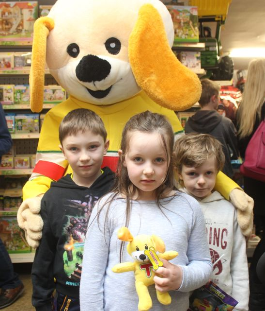 Jonathan and Sinead Galvin and Sean Og O'Leary Griffin at the Puppet Show at Caballs Toymaster as part of the Tir na nOg festival on Saturday morning. Photo by Dermot Crean