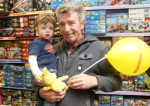 Fionn O'Regan with grandad Tom O'Brien at the Puppet Show at Caballs Toymaster as part of the Tir na nOg festival on Saturday morning. Photo by Dermot Crean