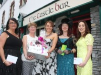 Sandra Leahy (centre) winner of the Best Dressed Lady competition at The Castle Bar on Wednesday receives her prize of a bouquet of flowers from Sheila O'Sulivan (second left). Also included is, from left; Aileen Riordan in third, Alex Buhl in fourth and Kim Kerins (second) . Photo by Dermot Crean