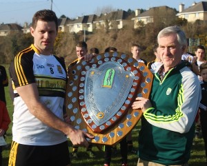Dr Crokes captain, Eoin Brosnan, collects the Credit Union County League Division 1 Shield from Kerry County Board  PRO, John O'Leary. Photo by Gavin O'Connor.