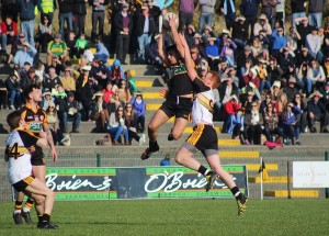 Austin Stacks, Wayne Guthrie, fetches a ball over Johnny Buckley of Dr Crokes. Photo by Gavin O'Connor.