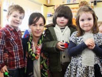 Teacher, Laura Ni Dhonghainle, with perhaps some future pupils at the Gaelscoil Mhic Easmainn open day. Photo by Gavin O'Connor.