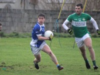 David Murphy of Kerins O'Rahillys comes away from Killarney Legion's Jamie O'Sullivan. Photo  by Dermot Crean
