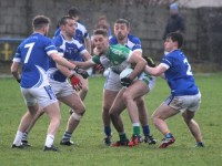 Kerins O'Rahillys players swarm on Legion player. Photo by Dermot Crean