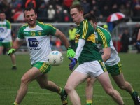 Colm Cooper about to tap over his second half point with Donegal's, Neil McGee in close quarters.  Photo by Dermot Crean.
