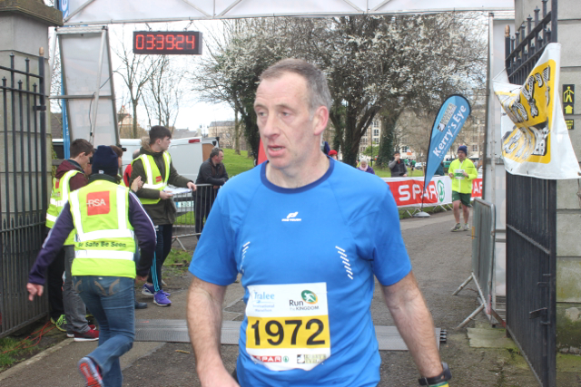 Its all over for this runner at the marathon finishing line on Saturday afternoon. Photo by Dermot Crean