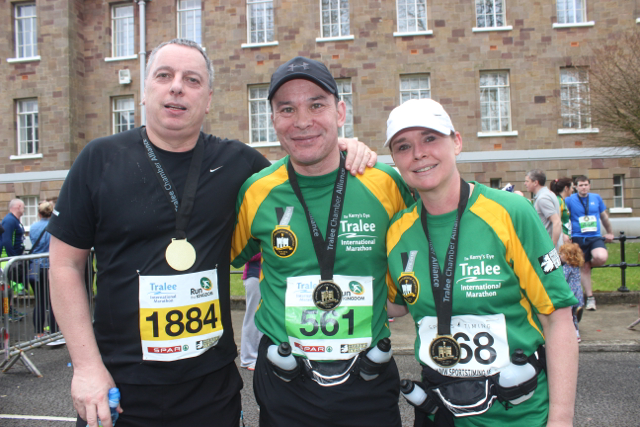 Chris Hannifin with Philip and Anne Sicat at the marathon finishing line on Saturday afternoon. Photo by Dermot Crean