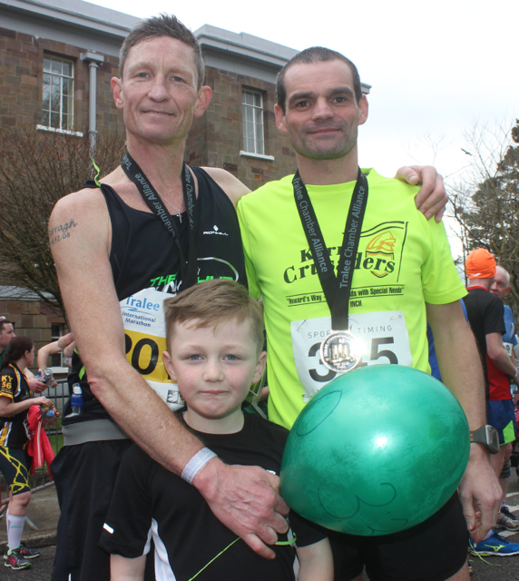 Chris and Darragh Grayson with Vincent O'Leary, at the marathon finishing line on Saturday afternoon. Photo by Dermot Crean