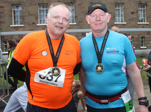 Kevin Finn and Paul Knightly at the marathon finishing line on Saturday afternoon. Photo by Dermot Crean
