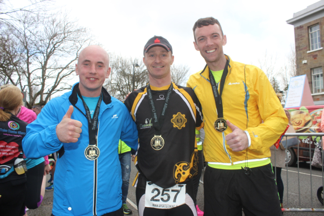John Johnson, Johnny O'laughlin and Jamie Hennebery at the marathon finishing line on Saturday afternoon. Photo by Dermot Crean