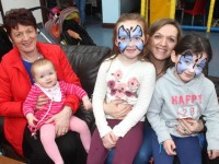 Breda Murphy with Aoife Martin and Gillian Martin holding Kate Martin and Maeve Murphy at the 'Fun At The Playdium' event as part of the Tír na nÓg Children's Festival on Friday. Photo by Dermot Crean